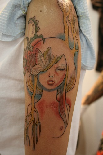 Big Wow for this #Tattoo fuckyeahtattoos:  I've got this done at the 2010 Singapore Tattoo Show. It's an illustration by Audrey Kawasaki, and I have been admiring her work for a few years now. Decided to get a this done by a renowned Japanese artist, check out his work here:Knuckle Energy Tattoo. Submitted by Yolanda.