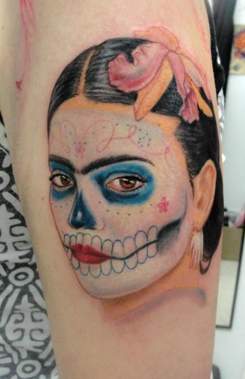 fuckyeahtattoos:  A portrait of Frida Kahlo done up as a sugar skull. She's part of my new half sleeve, which started yesterday (03.13.2010) Done by Angel Santana at Unholy Grail in Worcester, MA. If you click the picture it'll take you to his MySpace, where you can see the rest of his work.