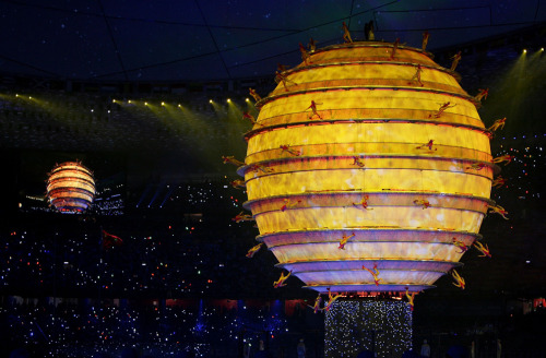 Artists perform around an illuminated Globe during the Opening Ceremony for the 2008 Beijing Summer Olympics at the National Stadium on August 8, 2008 in Beijing. (Streeter Lecka/Getty Images) via Boston.com