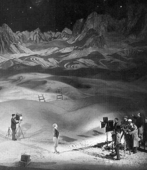 Fritz Lang, actress Gerda Maurus  & crew on the set of Woman in the Moon (1929, dir. Fritz Lang), which included a giant backdrop painting of a lunar landscape (click to enlarge) (via)