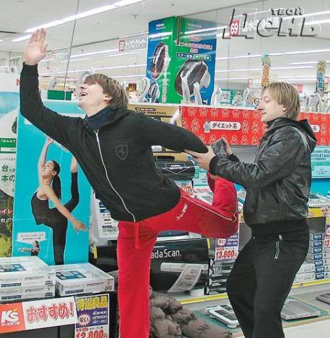 lovetheice:  rinkwithlove:   Alexi trying to be Mao Asada while Evgeni stares evily at his ankle and wrist. No words.   (via nordicbynature)