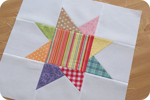 Cute wonky star… :) Love this playful mix of fabrics.