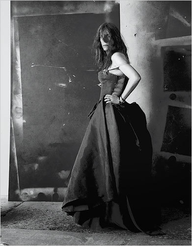 This photo of Patti Smith — poet, rock legend — in a Dior ballgown is perfection. photo links to NYTimes article