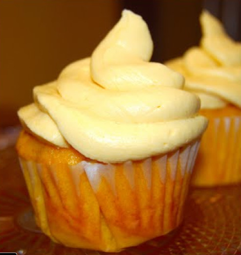 Mango Cupcakes with Mango Buttercream: all vegan GIVE IT TO ME. I really have nothing left to say. I mean, what is there? Maybe these might be better left to summer eating when mango is easily available, but I've got some stuff frozen from last summer in my freezer and I'm busting it out. Wait, will that kill me? Who cares! If I'm gonna go down, I want to go down eating these cupcakes. And preferably having sex on a cloud and getting a massage from Jude Law and petting my dog and eating French fries and accepting an Oscar and a Nobel Peace Prize and doing the can-can with a chorus of kittens YES ALL AT ONCE, PERV.