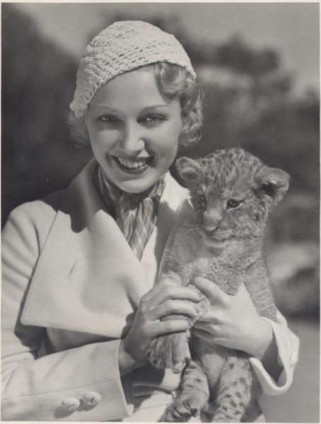 Miss Leila Hyams and a four footed friend. Circa: Late 20's/Early 30's