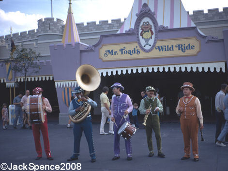 vintagedisneyparks:  The Pearly Band playing in front of Mr Toads Wild Ride, which is now home to the Winnie the Pooh dark ride.