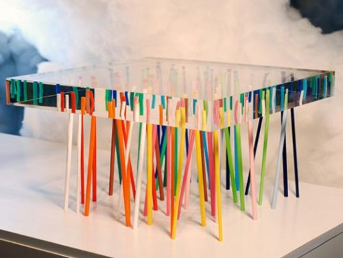 "HOLY SHIT! loveallthis:  By Emmanuelle Moureaux:  a table with 56 slender colored acrylic feet randomly arranged into a table top of transparent acrylic. ""The sticks support the transparent acrylic panel, while refracting and reflecting light as if they were soaking under water.""  from MoCo Loco."