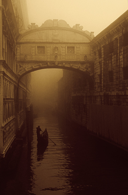Just another day punting a gondola through the fog enshrouded Ponte dei Sospiri (Bridge of Sighs)
