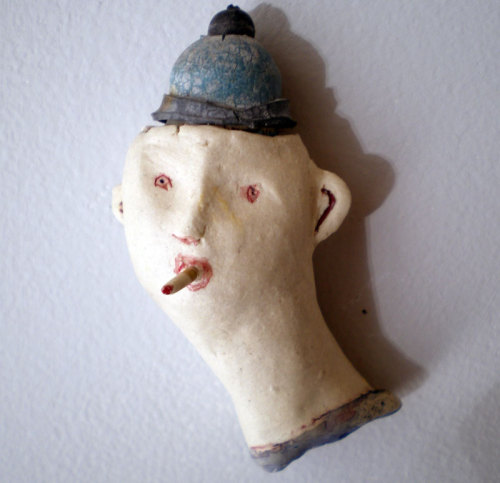 porcelain, glaze, paint, found object, 2010.  Everyone seems to recognize this as Kevin.  Maybe it is, maybe it isn't.  This smoker's cap is made from a remnant of my dog's rubber ball - it's belly button I suppose you would call it- I couldn't just throw it away.