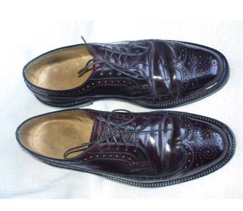 It's On eBay Vintage Nettleton Shell Cordovan Longwings The shell cordovan is easy to recognize - see how the leather rolls, rather than creasing?  Shell is the leather from the rump of a horse; it's quite expensive but exceptionally durable, and almost never needs more than a brushing to shine.  Nettleton were an American manufacturer who ceased production in the 80s, though the name was licensed for a bit thereafter.  High quality shoes. Buy it Now for $149.99