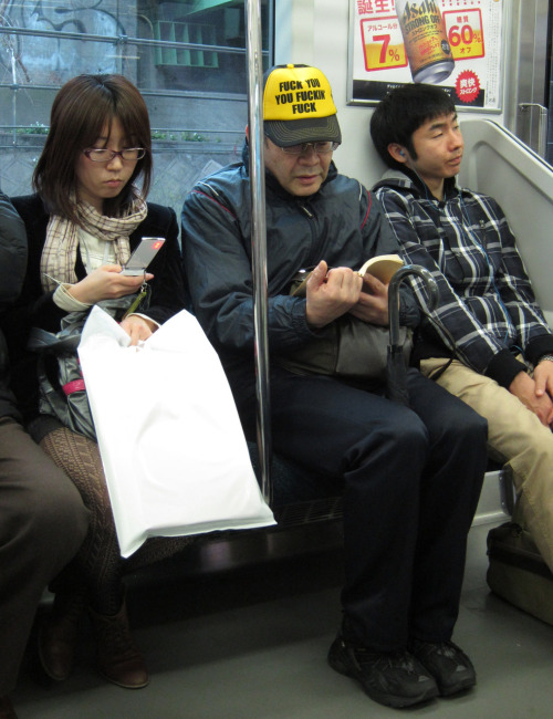 YOU HAVE GOTTA CHECK OUT THIS MAN'S HAT!! I took this photo on the Yamanote line today in Tokyo!! Photo by Brad Elterman