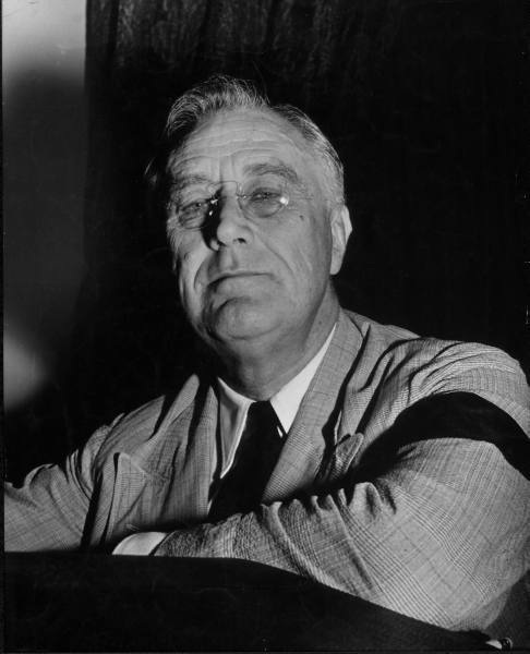 Franklin Roosevelt so admired his fifth cousin Theodore, who was elected president while he was an undergraduate at Harvard, that he took to wearing pince-nez glasses in emulation of him. FDR wore a pair of C-bridge pince-nez glasses for the rest of his life. There he is above, through the graces of LIFE's online photo archive, wearing them in 1941. Pince-nez glasses were very popular at the turn-of-the-century, when Teddy Roosevelt wore them. They were almost forty years out of fashion, however, by FDR's administration. So a president wearing pince-nez glasses in 1932 would be like an elected official today wearing a pair of black plastic frames because he admired Orville L. Freeman — a touchingly twee affectation. As an enthusiastic personal supporter of absurdly outdated, touchingly twee affected eyewear, I find that very, very inspiring.