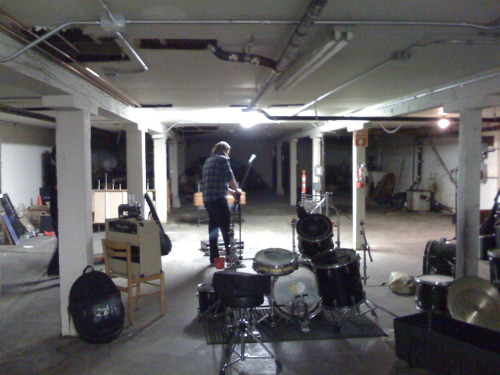 restaurant rehearsal space 1: Paul Dean Price setting up at our extravagant rehearsal space in a restaurant basement in Alameda. This place has great acoustics! It is actually really great being able to rehearse here (when the lights work! teehee :-)
