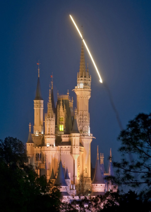 The closest we'll ever get to a streaking star behind the Disney castle thedailywhat:  Photo of the Day: Space Shuttle Discovery streaks across the early-morning sky above Walt Disney World on its way toward the International Space Station in this gorgeous shot by photographer Kent Phillips. When you wish upon a spaceship, etc. [joemygod.]