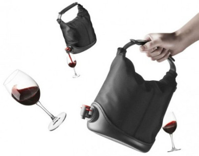 a purse for your wine: The Baggy Winecoat is a $58 purse for your wine. It's basically a glorified box and that's a-okay with me because I'll drink out of anything with alcohol in it.  Including, and not just limited to: your liver.  You think I  won't drug you and cut that thing out? [via:geekologie:@mollsrawks]