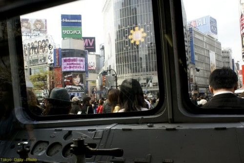 tokyodailyphoto:  This shot was taken from inside the green train next to the Hachiko statue next to Shibuya crossing.