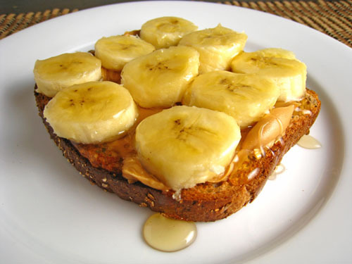 This peanut butter and banana sandwich drizzled with Grade B maple syrup has my name all over it. And by my name, I mean my mouth. And by my mouth, I mean my floor. Yes, I just made one and dropped it on my fucking floor.  OH IT'S ON, Today. You ain't seen from crazy yet! You better pack your sorry ass on outta here before midnight TONIGHT or I'm coming correct, you feel me??? (via yummyvegan)