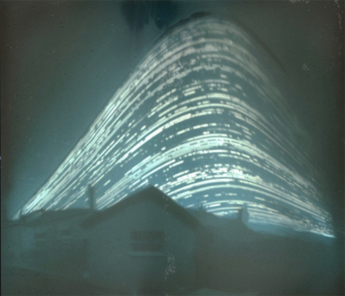 "Solar Path Recorded By Pinhole Camera Over Six Months - Mr mallon solar path - Gizmodo  Between the months of June and December last year, ""Mr. Mallon"" was filming the sun's activities on a single film cell, which lay forgotten in his back garden. This is the beautiful result. It's a pretty example of what you can do with pinhole photography, where you simply place a roll of film in a handmade camera (very easy to do, Mr. Mallonfollowed these instructions here), and leave it outside, ready to record the path of the sun in the sky. The film was scanned, and then made negative to illustrate the solar path clearly. Doesn't it look like vapor trails from a UFO, or some sort of warp field? [Help My Physics]"
