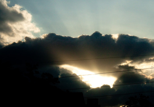 Kaleidoscopic sunlight through the clouds While driving through East Austin in search of a particular art cafe. We never did find it but I got this shot.  Photo - Maitreyi Roy, Somewhere on E 5th St, Austin, Apr '10