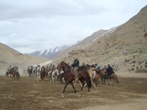 thepublics:  Buzkashi is a traditional Central Asian team sport played on horseback in Afghanistan,  Kyrgyzstan,  Tajikistan,  Pakistan,  Kazakhstan,  and Uzbekistan. The steppes' people were skilled riders who could  grab a goat  or calf  from the ground while riding a horse at full gallop. The goal of a  player is to grab the carcass of a headless goat or calf and then get it  clear of the other players and pitch it across a goal line or into a  target circle or vat. Further reading: War is Boring: Buzkashi,  Rougher than Politics New Zealand Herald: 'Mounted goat rugby from hell' may go global The Guardian: Kabul goes mad for wild sport