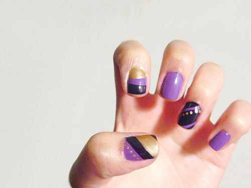 Purple and gold. 3rd week of purple nails ahaha.