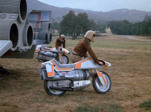 "Most awesome fictional futuristic motorcycle from the 80s: Battlestar Galactica ""Turbocycle"" or Robotech Veritech Cyclone mecha bikes?  Discuss…"