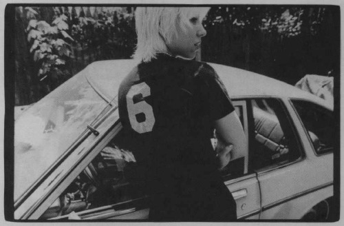 "Christina Billotte with her 1981 Datsun 210, sometime in the 1990s. Photo by Cynthia Connolly. Hey, good news: it's Christina Billotte Week here on S. 12th. It is going to be all-Christina-Billotte-all-the-time around here for the next several days.  Who is Christina Billotte? That is the question I am here to answer. The basics are this: she is a singer and guitarist, formerly based in Washington DC, who has played in four different bands — Autoclave, Slant 6, Quix*o*tic, and the Casual Dots. That's what Wikipedia would tell you, and I should know, because I actually created the Wikipedia entry. If I was to list ""Wikipedia contributor"" under the ""other professional experiences"" heading on my CV, that is what I'd be referring to. Hers is actually the only Wikipedia entry I have ever created. I believed the work of Christina Billotte to be so important I took the trouble to create a Wikipedia article about her. That should tell you that I take her work seriously. As far as I can tell, Billotte has made only six full-length records since 1991, and one of those was more of a compilation than a fully realized work. I wouldn't go as far as describing her as ""enigmatic"" or ""shrouded in mystery,"" but there's really not much information out there on her. I haven't read many interviews with her, and she doesn't seem to have any sort of online presence at all. There's a fan page for one of her defunct bands on MySpace that looks several years old, and a few profiles on the pages of record labels she's recorded with (Dischord, Kill Rock Stars). Otherwise, no website, no Facebook fan page, no Twitter account where she trades #quips with other notable punk legends of the 1990s. If she's made any new music in the last six years, I haven't heard about it. I met her once, in 2003. I interrupted a conversation she was having with Dave Pajo and I made her sign a CD. Good for me. Maybe I will upload an image of the autographed CD as part of the festivities.  I have loved her music for almost fifteen years; I love it enough to devote a week's worth of posts to it. This week, S. 12th will be a sort of annotated retrospective mid-career Billotte mixtape. It will be an introduction to her work, and an appreciation of the ways in which it's been a part of my own life in that time. That's one of the things that I think blogs can be very good for: chasing down little monomanias using short-form text mixed with other types of media, over a period of time, until it all coalesces into something approaching a portrait. That's more or less the plan for this week. We will be return to the sort of South Minneapolis spring/summer-themed tales of action and intrigue you have come to expect from S. 12th next week. Until then: the incredible Christina Billotte!"