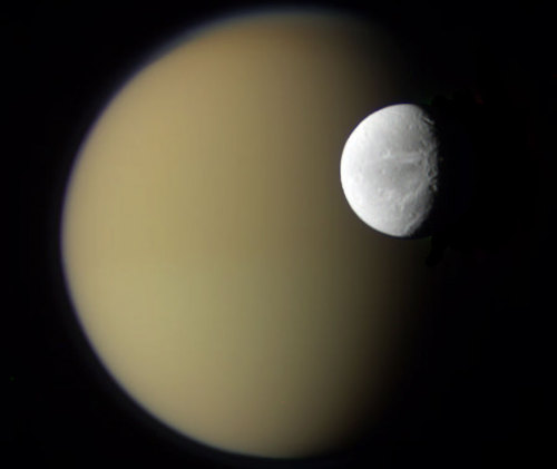 uraniaproject:   APOD: 2010 April 20 - Saturns Moons Dione and Titan from Cassini