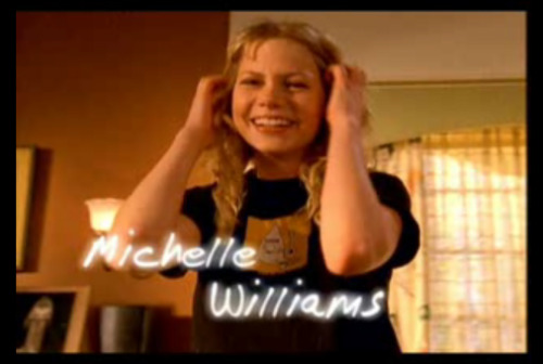 "Michelle Williams wearing a Kind of Like Spitting shirt on ""Dawson's Creek""."