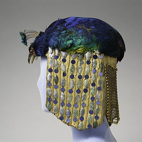 Peacock  Headdress, ca. 1913 Peacock feathers and head, cloth, metal, sequins, and celluloid  paillettes; 10 x 6 ½ x 8 ½ in. (25.4 x 16.5 x 21.6 cm) Museum of the City of New York, Gift of Julia Tiffany Weld (75.21.1) http://www.metmuseum.org/special/tiffany_laurelton/view_1.asp?item=28