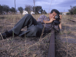 A Place To Think: Sadness (1999)  William Yang has worked as a photographer and theatre performer for over three decades. Descended from Chinese grandparents who migrated to Northern Australia in the 1880s, Yang was born William Young in 1943. After visiting China in the mid 1980s he changed his name to Yang in recognition of his Chinese heritage. During the 1990s, Yang developed and performed a series of thought-provoking monologues, using projected slides for illumination. His third monologue Sadness wove together two themes: the discovery of the artist's Chinese heritage and the rituals of dying and death in Sydney particularly as it effected many men with HIV aids. This show toured nationally and internationally to critical and popular acclaim. As well as performing his celebrated monologues all over the world, Yang is internationally recognised as a photographer with over twenty solo photographic exhibitions across Asia, Australia, Europe and North America.  Favorite pic of Yang, apart from his own self portraits. taken by Anna Zahalka.