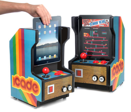 Enter the iCade iPad Arcade Cabinet! To use the iCade, gently slide the  iPad into the docking cradle.  The docking cradle uses a standard 30 pin  connector to link the iPad to the professional-grade arcade  controls.   Once the iPad is in place, launch the iCade App and it's game on!  via ThinkGeek