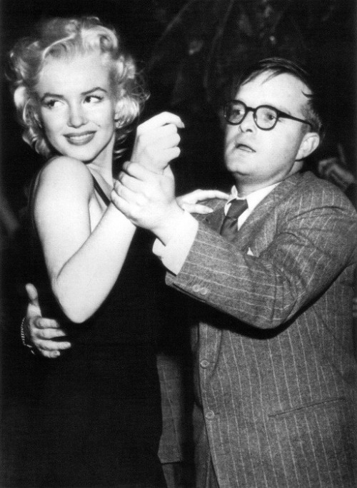 "Marilyn Monroe & Truman Capote dance at El Morocco in New York (1955, via Bettmann/Corbis) Monroe & Capote were good friends and drinking buddies during the   last decade of her life. In 1980, Capote released Music  for  Chameleons, a collection of short works that included an  account  of an afternoon he spent with Monroe in 1955. We'll never know  if and  how their conversations were embellished by Capote (who claimed  to have  transcribed his talk with Monroe in his diaries later that same   afternoon), but they certainly make for entertaining reading. An excerpt from the piece, which was titled A Beautiful Child: TC:  Now do you think we can get the hell out of here?  You promised   me champagne, remember? MARILYN:  I remember.  But I don't have any money. TC:  You're always late and you never have any money.  By any chance   are you under the delusion that you're Queen Elizabeth? MARILYN:  Who? TC:  Queen Elizabeth.  The Queen of England. MARILYN:  (frowning)  What's that cunt got to do with it? TC: Queen Elizabeth never carries money either. She's not allowed to.   Filthy lucre must not stain the royal palm. It's a law or something. MARILYN:  I wish they'd pass a law like that for me. TC:  Keep going the way you are and maybe they will. MARILYN:  Well, gosh.  How does she pay for anything?  Like when she   goes shopping? TC:  Her lady-in-waiting trots along with a bag full of farthings. MARILYN:  You know what?  I'll bet she gets everything free.  In   return for endorsements. TC: Very possible. I wouldn't be a bit surprised. By Appointment to   Her Majesty. Corgi dogs. All those Fortnum & Mason goodies. Pot.   Condoms. MARILYN:  What would she want with condoms? TC:  Not her, dopey.  For that chump who walks two steps behind.    Prince Philip. MARILYN: Him. Oh, yeah. He's cute. He looks like he might have a nice   prick. Did I ever tell you about the time I saw Errol Flynn whip out   his prick and play the piano with it? Oh well, it was a hundred years   ago, I'd just got into modeling, and I went to this half-ass party, and   Errol Flynn, so pleased with himself, he was there and he took out his   prick and played the piano with it. Thumped the keys. He played You   Are My Sunshine.  Christ!  Everybody says Milton Berle has the   biggest schlong in Hollywood.  But who cares?  Look, don't you   have any money? TC:  Maybe about fifty bucks. MARILYN:  Well, that ought to buy us some bubbly. (Outside, Lexington Avenue was empty of all but harmless   pedestrians. It was around two, and as nice an April afternoon as one   could wish: ideal strolling weather. So we moseyed toward Third Avenue. A   few gawkers spun their heads, not because they recognized Marilyn as the Marilyn, but because of her funeral finery; she giggled her special   little giggle, a sound as tempting as the jingling bells on a Good Humor   wagon, and said: ""Maybe I should always dress this way. Real   anonymous."" As we neared P.J. Clarke's saloon, I suggested P.J.'s might be a good   place to refresh ourselves, but she vetoed that: ""It's full of those   advertising creeps. And that bitch Dorothy Kilgallen, she's always in   there getting bombed. What is it with these micks? The way they booze,   they're worse than Indians."" I felt called upon to defend Kilgallen, who was a friend, somewhat,   and I allowed as to how she could upon occasion be a clever funny woman.   She said: ""Be that as it may, she's written some bitchy stuff about  me.  But all those cunts hate me. Hedda. Louella. I know you're supposed  to  get used to it, but I just can't. It really hurts. What did I ever  do to  those hags? The only one who writes a decent word about me is  Sidney  Skolsky. But he's a guy. The guys treat me okay. Just like maybe  I was a  human person. At least they give me the benefit of the doubt.  And Bob  Thomas is a gentleman. And Jack O'Brian."" We looked in the windows of antique shops; one contained a tray of   old rings, and Marilyn said: ""That's pretty. The garnet with the seed   pearls. I wish I could wear rings, but I hate people to notice my hands.   They're too fat. Elizabeth Taylor has fat hands. But with those eyes,   who's looking at her hands? I like to dance naked in front of mirrors   and watch my tits jump around. There's nothing wrong with them. But I   wish my hands weren't so fat."" Another window displayed a handsome grandfather clock, which prompted   her to observe: ""I've never had a home. Not a real one with all my own   furniture. But if I ever get married again, and make a lot of money,  I'm  going to hire a couple of trucks and ride down Third Avenue buying   every damn kind of crazy thing. I'm going to get a dozen grandfather   clocks and line them all up in one room and have them all ticking away   at the same time. That would be real homey, don't you think?"")  (…) MARILYN: Remember, I said if anybody ever asked you what I was like,   what Marilyn Monroe was really like—well, how would you answer them?   (Her tone was teaseful, mocking, yet earnest, too: she wanted an honest   reply.) I bet you'd tell them I was a slob. A banana split. TC:   Of course. But I'd also say… (The light was leaving. She seemed to fade with it, blend   with the sky and clouds, recede beyond them. I wanted to lift my voice   louder than the seagulls' cries and call her back: ""Marilyn! Marilyn,  why  did everything have to turn out the way it did? Why does life have  to  be so rotten?"")  TC: I'd say… MARILYN: I can't hear you. TC: I'd   say you are a beautiful child. *** A full-ish version of the piece was published in People in   1980 & can be read here (""full-ish"" because in a concession to propriety, People excised, among other things, Monroe's colorful nickname for Queen   Elizabeth and any references to Errol  Flynn's piano-playing penis). Incidentally, Capote had actually wanted Monroe to play the part of   Holly Golightly in Breakfast at Tiffany's. Capote: ""Marilyn  would  have been absolutely marvelous in it. She wanted to play it too,  to the  extent that she worked up two whole scenes all by herself and  did them  for me. She was terrifically good, but Paramount  double-crossed me in  every way and cast Audrey. Audrey is an old friend  and one of my  favorite people, but she was just wrong for that part."""