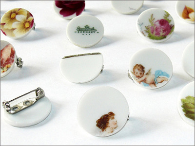 Ceramic badges and pendants from porcelain plates via mischer'traxler. This makes me want to bust out a tile cutter…