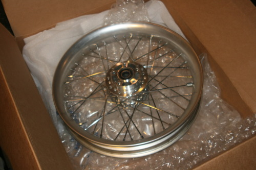 got my front wheel in the mail and gas tank!!!