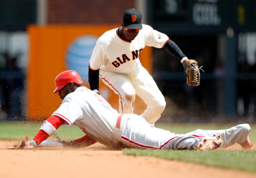 Ryan Howard learned his lesson about sliding into second base on doubles hit to Nate Schierholtz. (Photo by Jed Jacobsohn/Getty Images)