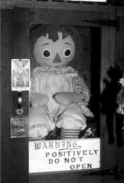 "fuckyeahparanormalresearch:  The story behind this doll is she belonged to a couple of nurses when the phenomena started. ""The doll started to move around the apartment by itself. I don't mean it got up and walked around, or any such thing. I mean when we'd come home from work it would never be quite where we left it."" The dolls legs and arms would move from the position it was left in.  Things got even stranger from then on. The doll would end up in completely different rooms then where she belonged. The doll would be found kneeling by the front door, and would leave notes around the home with parchment paper which they did not own. The owners called a psychic to explain the odd things going on with the doll. The psychic told them the spirit of a seven year old girl named Annabelle was killed in the area and was now living in the doll. They accepted this and began calling her Annabelle. They then began treating her like a human because they had compassion for the poor girl. Lou, one of the nurses friends was at the apartment and heard something that sounded like someone breaking into the house. He went into the room that the noise came from and all that was wrong was Annabelle was laying in the corner of the room. He walked toward it and felt like someone was behind him and at the moment he turned around he felt a sharp pain in his chest. He ran out of the room holding his chest. When he opened his shirt him and Angie (one of the nurses) saw 3 vertical and 4 horizontal claw marks on his chest. The marks were not ordinary cuts, they were hot and felt more like burns. After this they realized they needed to contact Ed and Lorraine Warren, two of the most well known and respected demonoligist/paranormal researchers in the world. Ed listened to these stories and took the doll deciding they were subject to a demonic posession not a 7 year old girl living in a doll. The doll remains to this day in the Warrens Occult museum where this picture was taken.  I WANT TO GO TO THIS MUSEUM."
