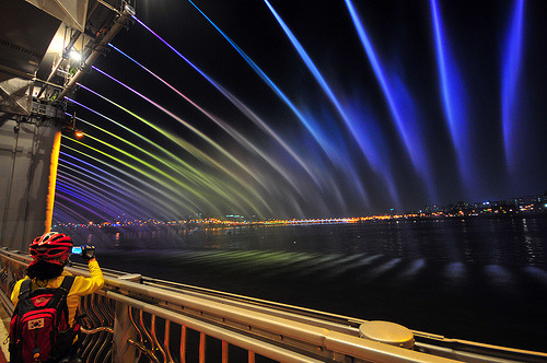travelhighlights:    The Banpo Bridge (반포대교)  is a major bridge in downtown Seoul over the Han River, South Korea, connecting the Seocho and Yongsan districts.  The Moonlight Rainbow Fountain (달빛무지개 분수) is the world's longest bridge fountain that set a Guinness World Record with nearly 10,000 LED nozzles that run along both sides that is 1,140m long, shooting out 190 tons of water per minute.  The project is the first of its kind in the world. credits: wikipedia  Hmm. I'm really close to this bridge. But I never  been here. (after LED installed)  may be today . I'll be here.