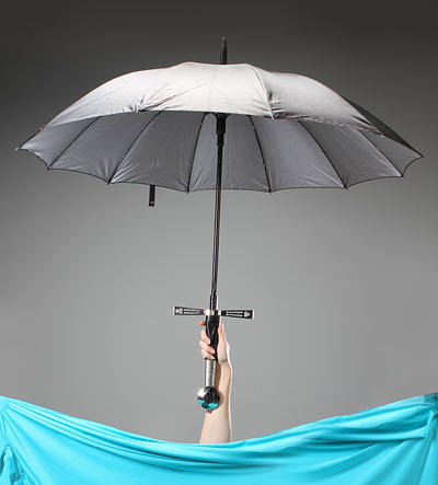 ThinkGeek :: Broadsword Handle Umbrella This would make rainy days so much more fun, AND fulfill my not-so-secret desire to carry a sword with me wherever I go.