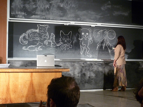 Antonia Neshev (Three Wolf Moon artist) sketches on the boards at ROFLcon (by urlesque)