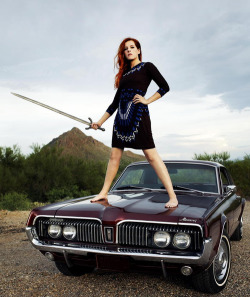 "Neko Case ""Middle Cyclone"" cover photo outtake, by Jason Creps ""I have this poster at work. Neko looks over my right shoulder as I work. She also taps me on the head, with the sword, when I stare at her legs too long."" -"