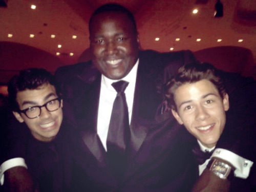 Aw, Nick's smiling! L to R: Joe, Quinton Aaron (The Blind Side) & Nick