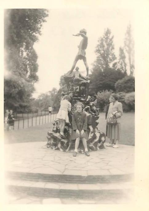 Janet & Sylvia at Peter Pan's Statue, 1953 The back of the photo says Peter Pan's Statue. Sir George Frampton sculpted seven models of this statue. It's hard to tell whether this is the version in Kensington Gardens, London; or Sefton park Liverpool. Liverpool would have been nearer and other images clearly show the girl on the statue there (presumably Wendy?) However the background setting resembles other pictures in Kensington Gardens more closely, but the girl figure appears to be missing off those images. I plan to ask Janet (mum) and (Aunty) Sylvia where they were and what they remember about it.
