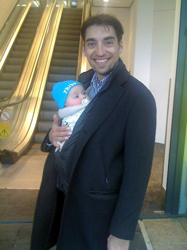 Daddy and Thibault (now 5 months old) dropped by the office for a quick visit during my lunchbreak today. I work near a mall in Rotterdam, the Netherlands. They are sporting a Mei Tai this time, because Dad is not a big fan of the (stretchy) wrap. (via Zayma)