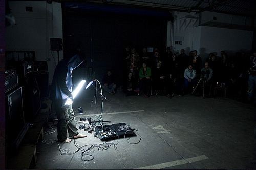 astronautte:   A sound artist, Atsuhiro Ito performs using his device the Optron, essentially fluorescent light tubes with integrated guitar pick-ups sent through guitar amp stacks.  Check out this video too. He's collaborating with The Analog Girl and Zai Kuning at the Singapore Arts Festival, be there or weep.  Whoa. 5th June at supperclub, guys