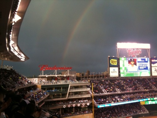 Double rainbow over Target Field on Tuesday night. At it's fullest, the double rainbow stretched from where it is in the image above all the way across the outfield and into the skyline. Quite a beautiful sight.