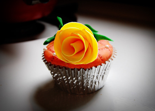 This is the cupcake I made for my Mom for Mother's Day.  I picked a yellow rose because my mom and I have become more than mother and daughter in the past few years; we've become friends too.   That's the best mother's day gift of all.  And yellow roses are her favorite.  Happy Mother's Day Mom!! I love you!   And happy Mother's Day to all the women who wake up every morning knowing the best gift they could ever ask for is busy shoving peanut butter into the DVD player. Today's your day! Let Dad scrape it out this time.