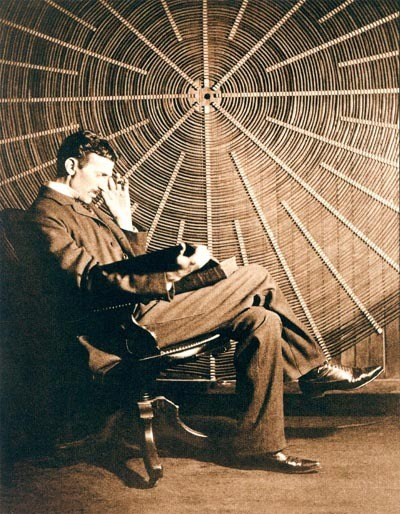 "turnofthecentury:  Nikola Tesla, the great inventor and engineer He's reading Rudjer Bošković's book ""Theoria Philosophiae Naturalis"" [iconic photo,few more here] submission from  raise & quell"