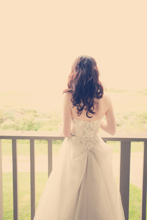 This dress is so pretty. And i love the bride's hair, too.