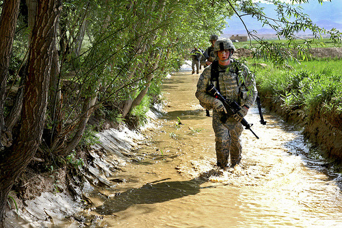 U.S. Army solders travel dismounted through a creek in the village of Babus, May 7, Pole-Elam District, Afghanistan. The soldiers are assigned to 264th Route Clearance Company, 27th Engineer Battalion, Task Force Tiger Engineer Brigade.